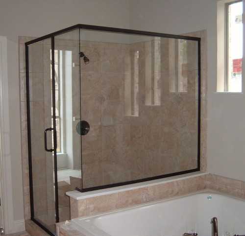 Semi-frameless shower enclosures