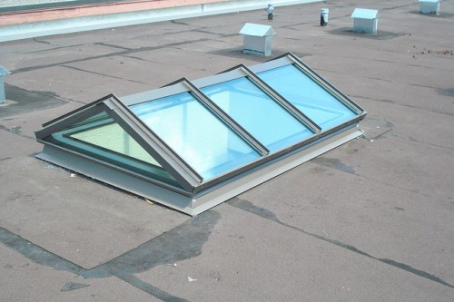 Double pitched with gable skylights