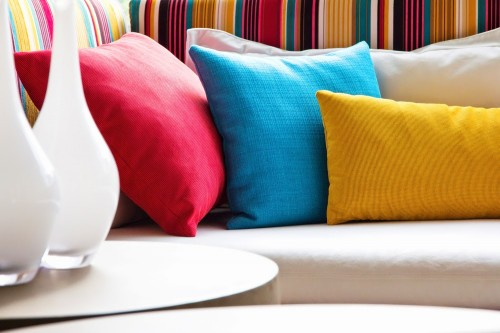 Add bright pillow colors to your rooms