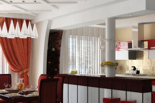 Hang a curtain in between the dining area and the kitchen