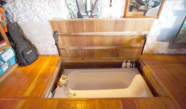 Hidden floor tub with latch door